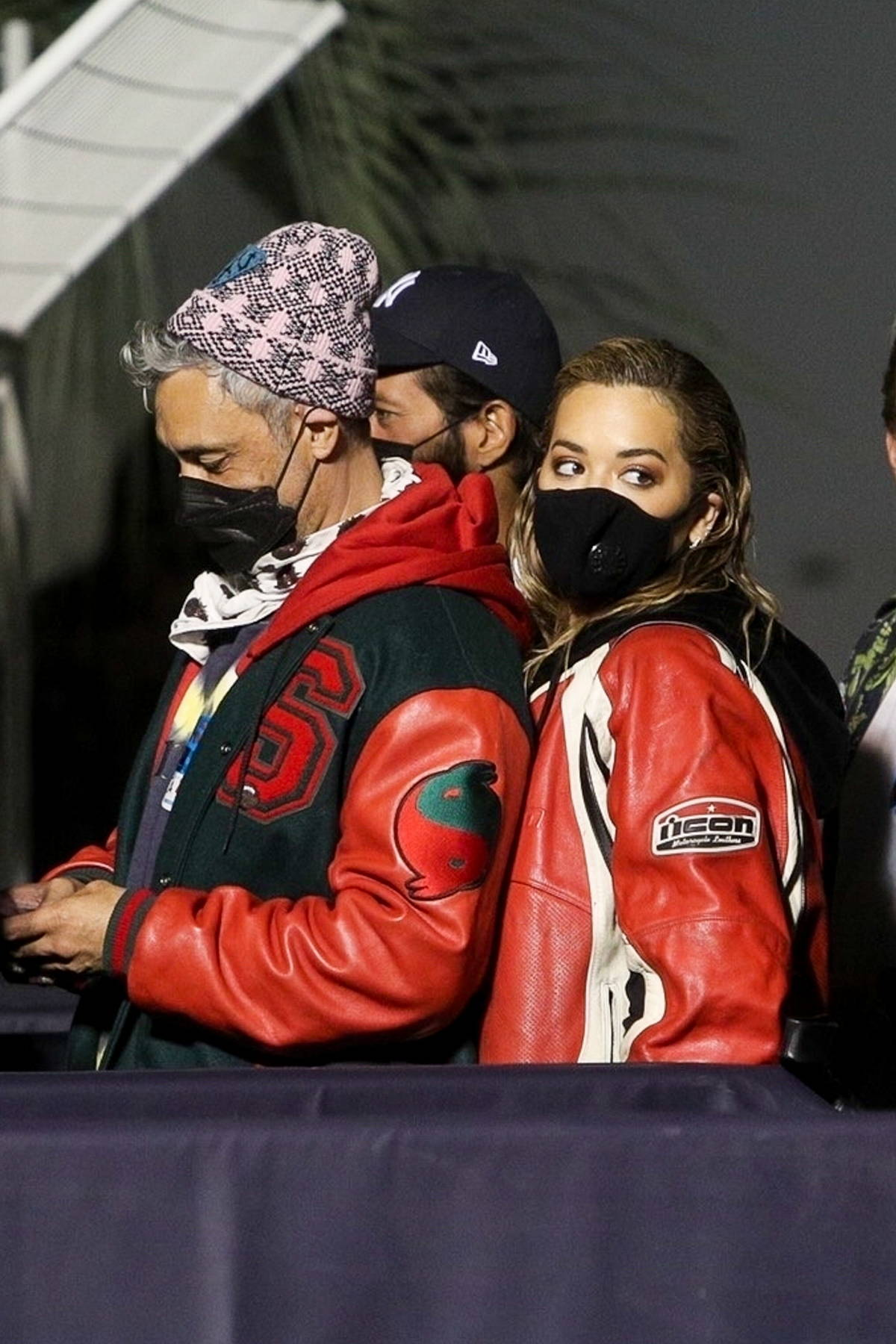 Rita Ora and Taika Waititi wait in the VIP line at The Rolling Stones concert in Los Angeles
