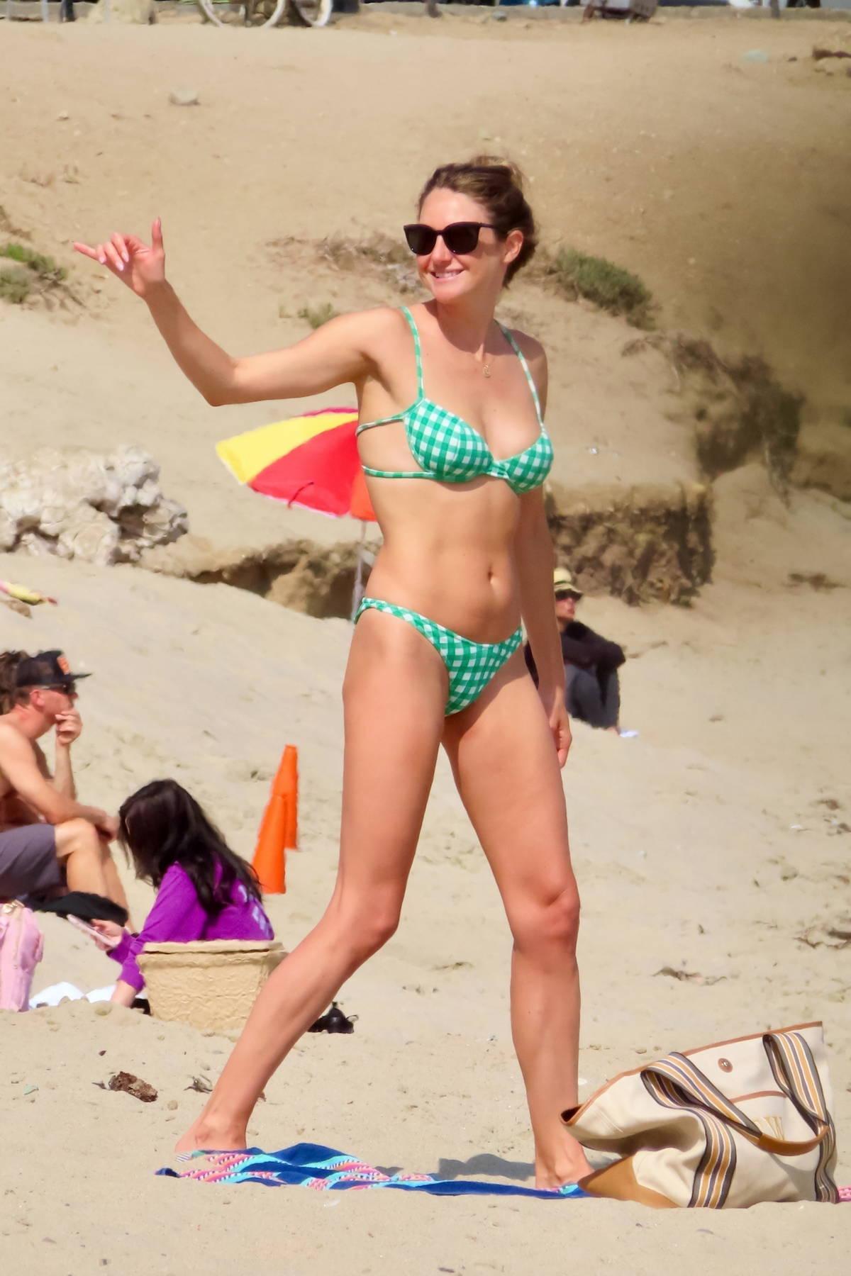 Shailene Woodley looks incredible in a green gingham bikini while enjoying a beach day in Malibu, California