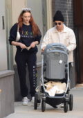 Sophie Turner and Joe Jonas enjoy a leisurely stroll with their baby daughter in New York City