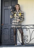 Suki Waterhouse seen filming with vintage cars and video cameras for a photoshoot in a run down motel in Los Angeles