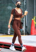 Vanessa Hudgens shows off her toned body in brown leggings and workout top as she hits the Dogpound gym in Los Angeles